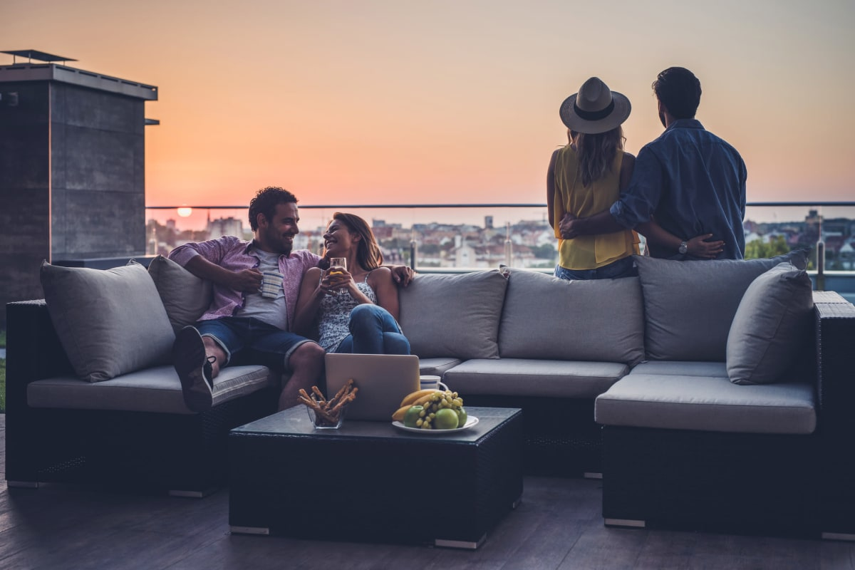 Residents enjoying a rooftop lounge at Enchanted Springs Apartments in Colorado Springs, Colorado