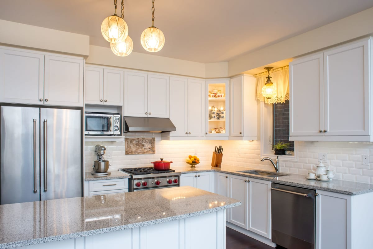 Granite countertops and stainless-steel appliances in a model home's kitchen at The Pointe at Siena Ridge in Davenport, Florida