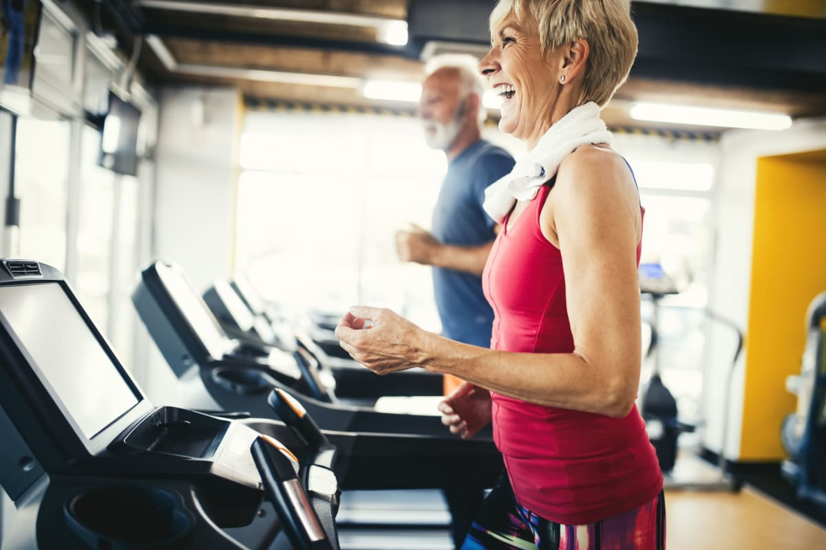 Residents staying in shape in the fitness center at The Pointe at Siena Ridge in Davenport, Florida