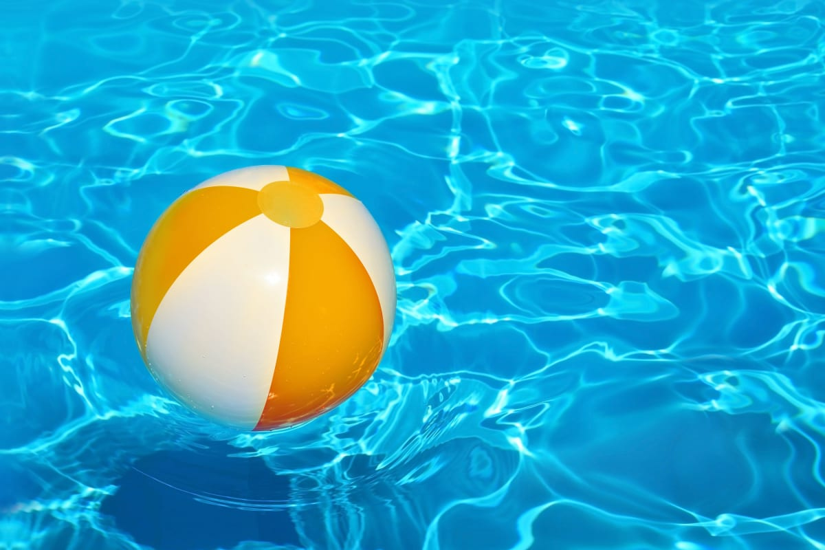 Beach ball in the swimming pool on a beautiful day at The Pointe at Siena Ridge in Davenport, Florida