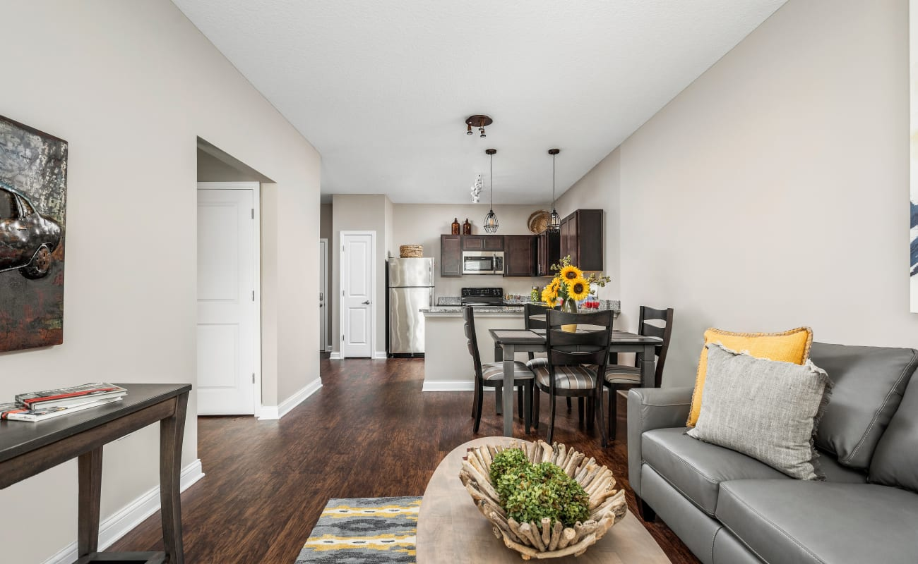 Spacious and well-decorated open-concept living area of a model home at Bonterra Apartments in Fort Wayne, Indiana