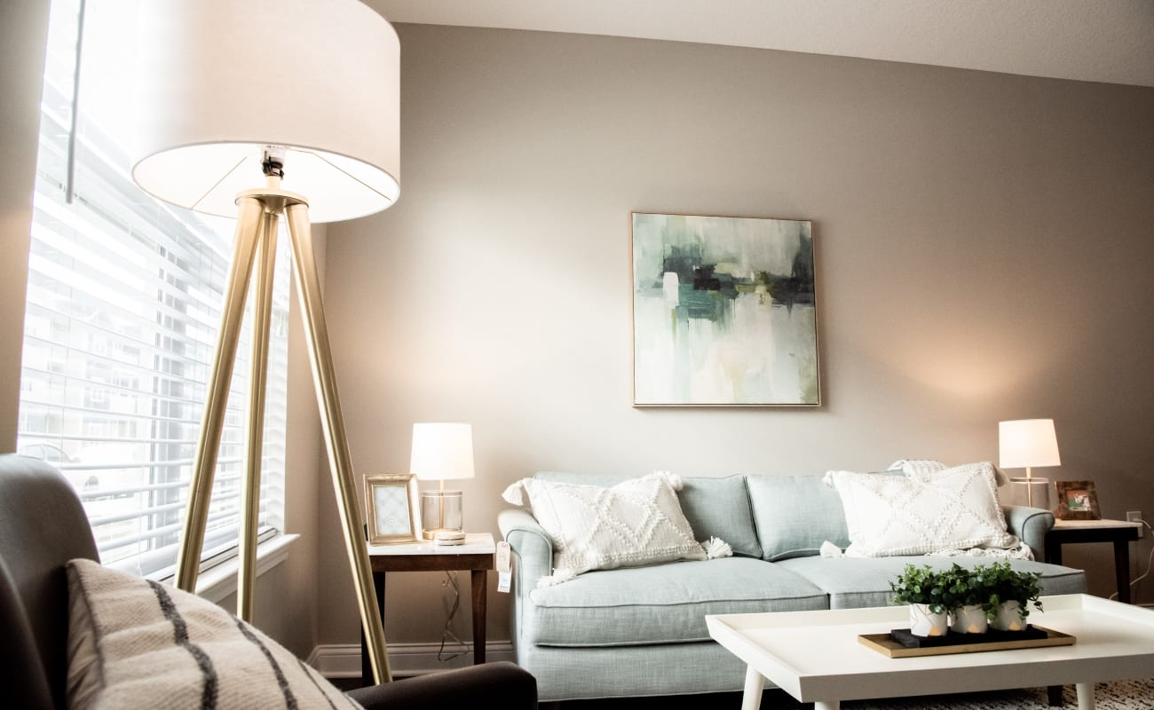 Cozy living area in a model home at Bonterra Apartments in Fort Wayne, Indiana