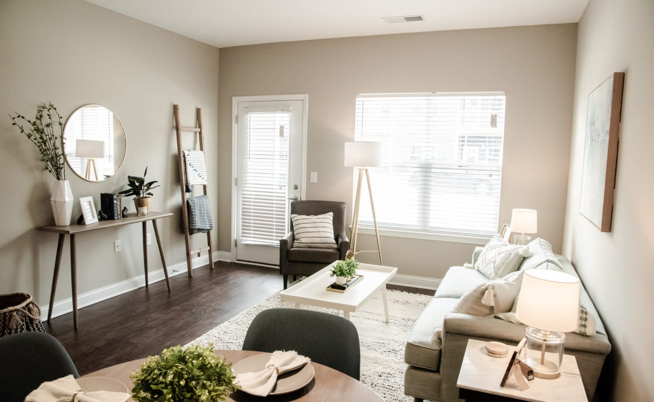 Large bay windows in a model home's living area at Bonterra Apartments in Fort Wayne, Indiana