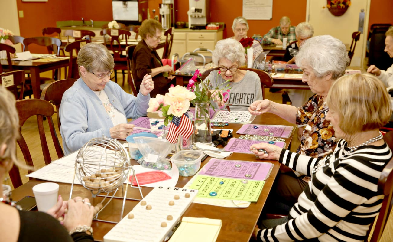 Residents enjoying a game of bingo at Providence Assisted Living in Clarksville, Arkansas.