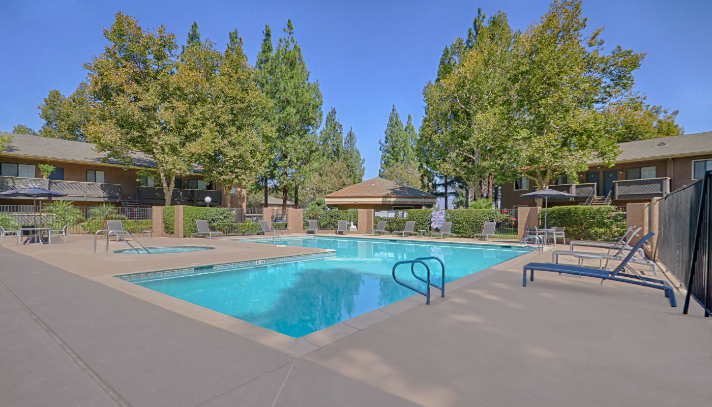 Beautiful swimming pool area at Creekside Village Apartment Homes in San Bernardino, CA
