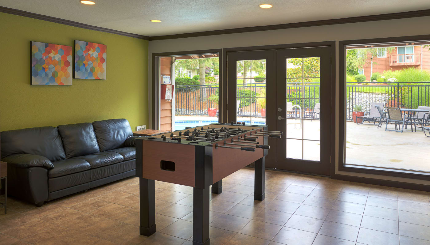 Foosball and more in the clubhouse at The Boulevard at South Station Apartment Homes in Tukwila, Washington