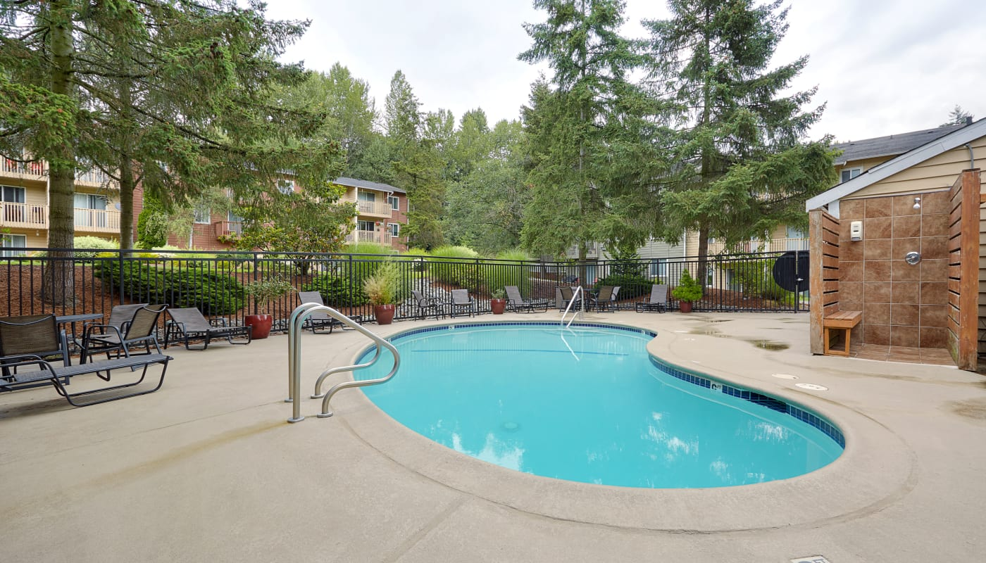 Gorgeous swimming pool area at The Boulevard at South Station Apartment Homes in Tukwila, Washington