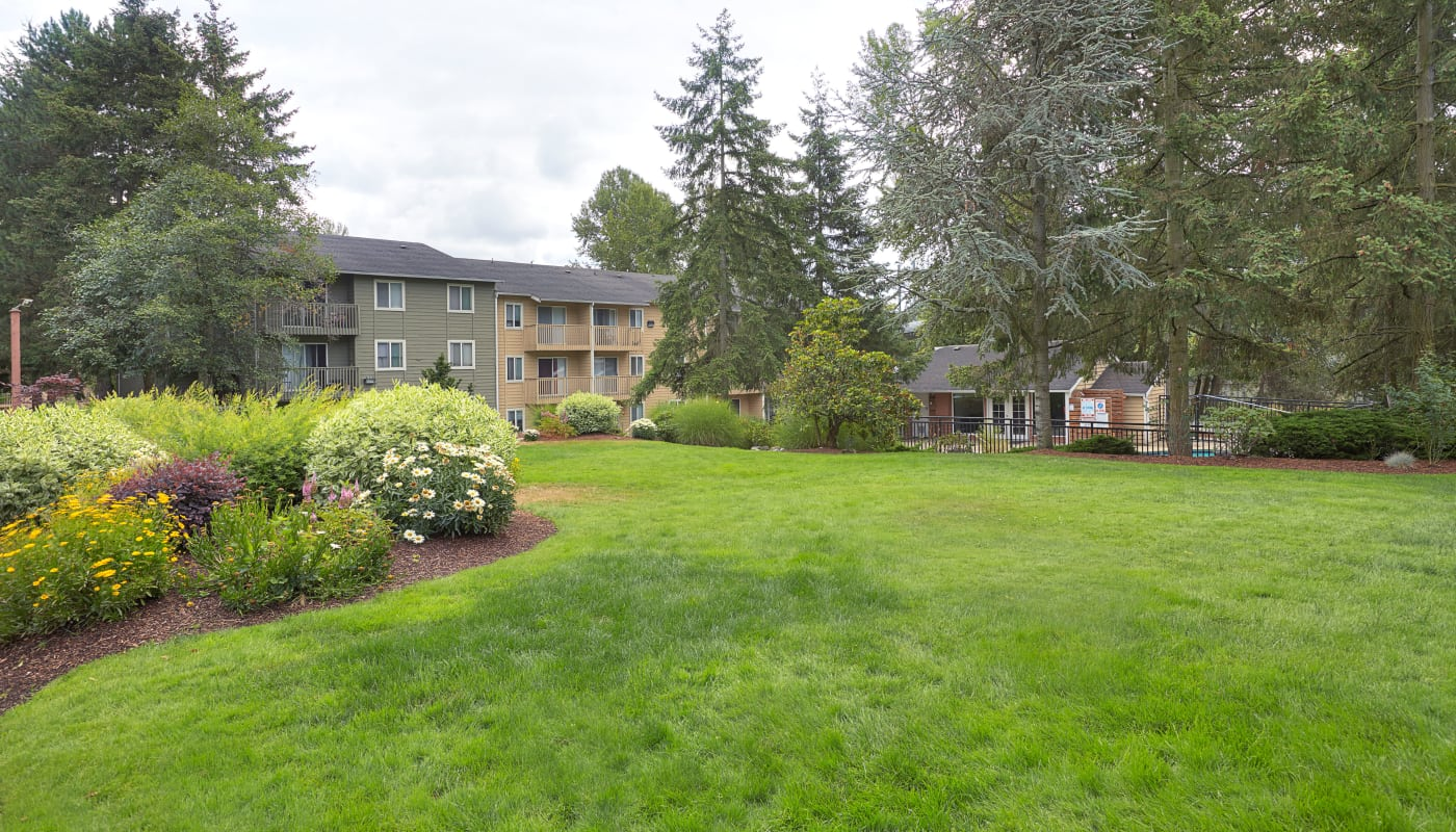Beautiful green spaces and well-kept grounds at The Boulevard at South Station Apartment Homes in Tukwila, WA