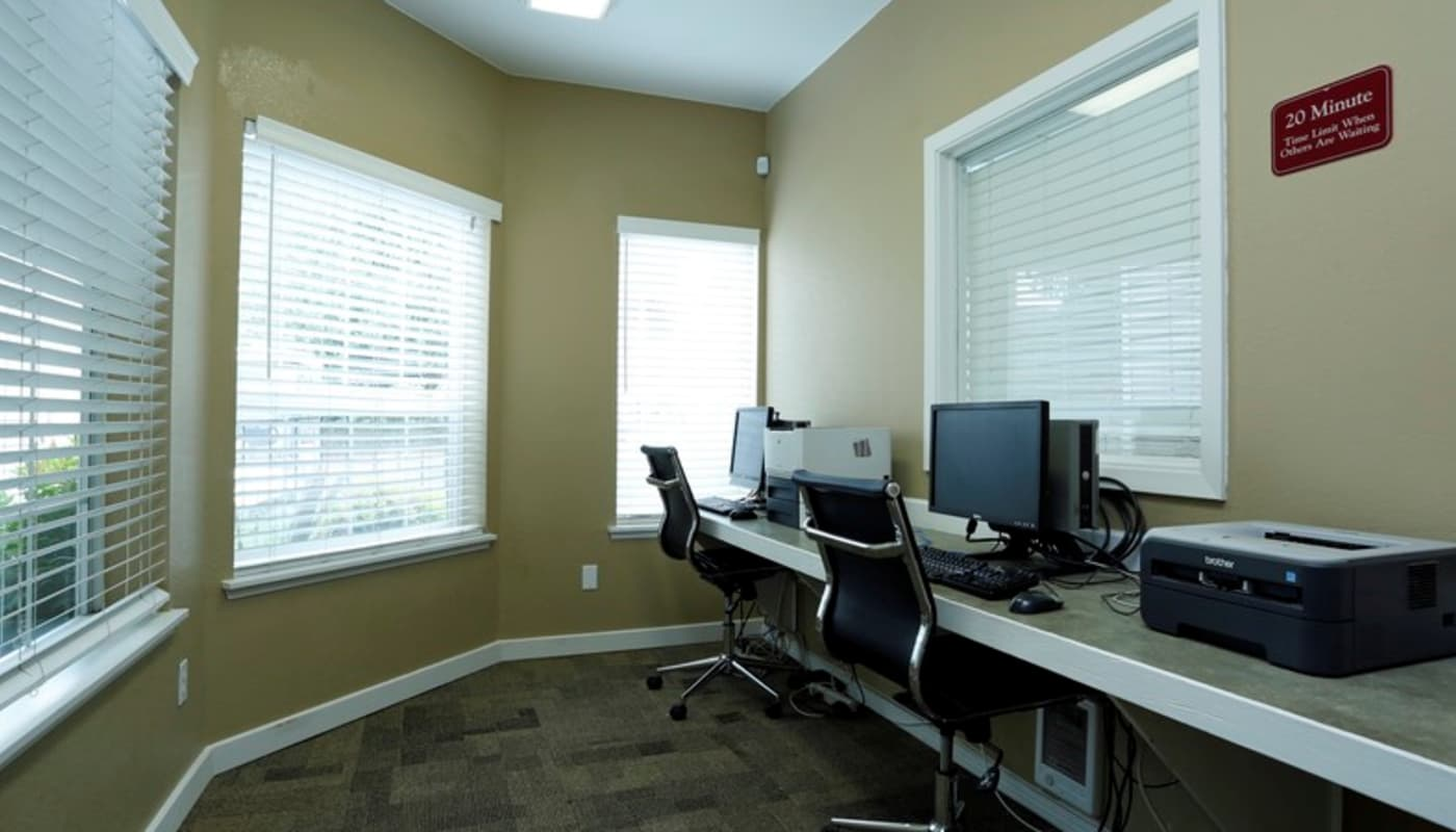 Business center with computers for resident use at Discovery Landing Apartment Homes