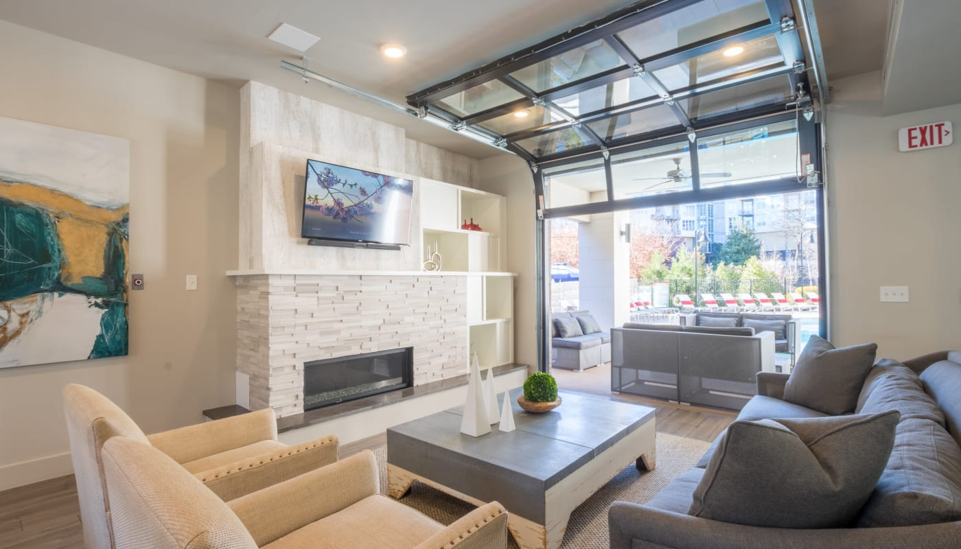 Indoor seating area with fireplace and television at Inman Quarter