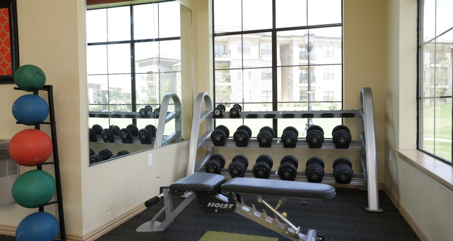 Free weights and more in the fitness center at Evolv in Mansfield, Texas
