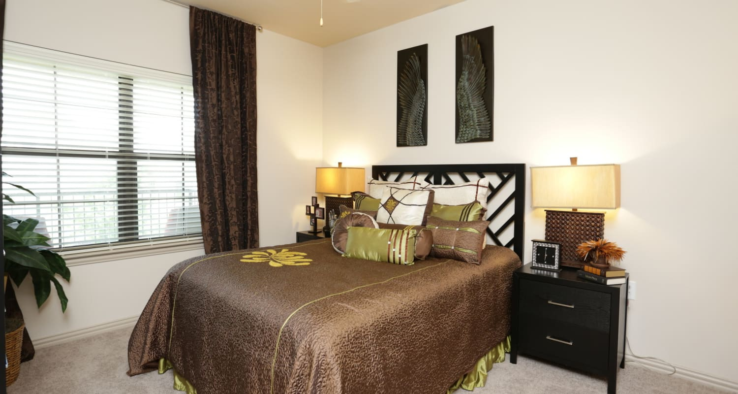 Master bedroom with plenty of natural light in model home at Evolv in Mansfield, Texas