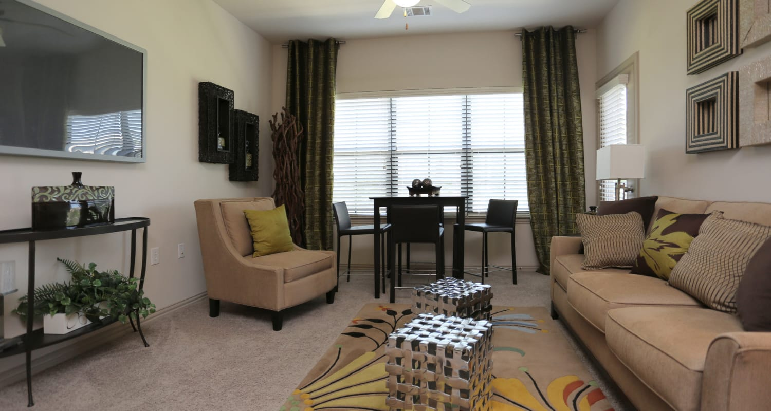 Spacious and well-decorated living room of model home at Evolv in Mansfield, Texas