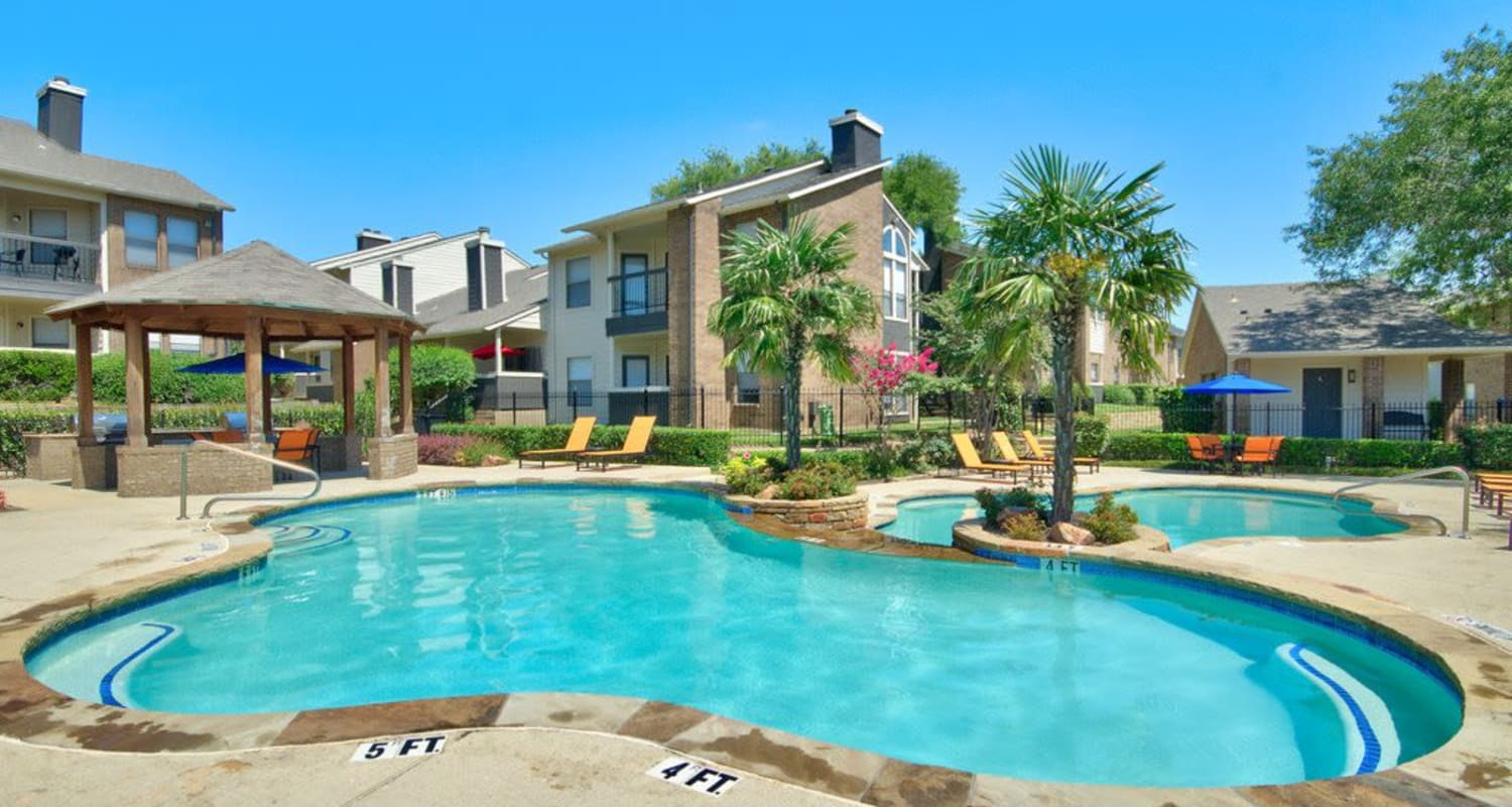 Enjoy our shimmering pool at Ridgeview Place in Irving, Texas