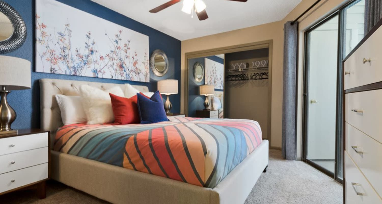 Naturally well-lit bedroom at Ridgeview Place in Irving, Texas