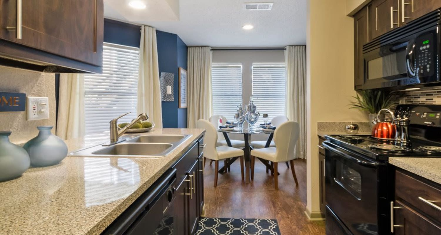 Dining room and beautiful kitchen at Ridgeview Place in Irving, Texas