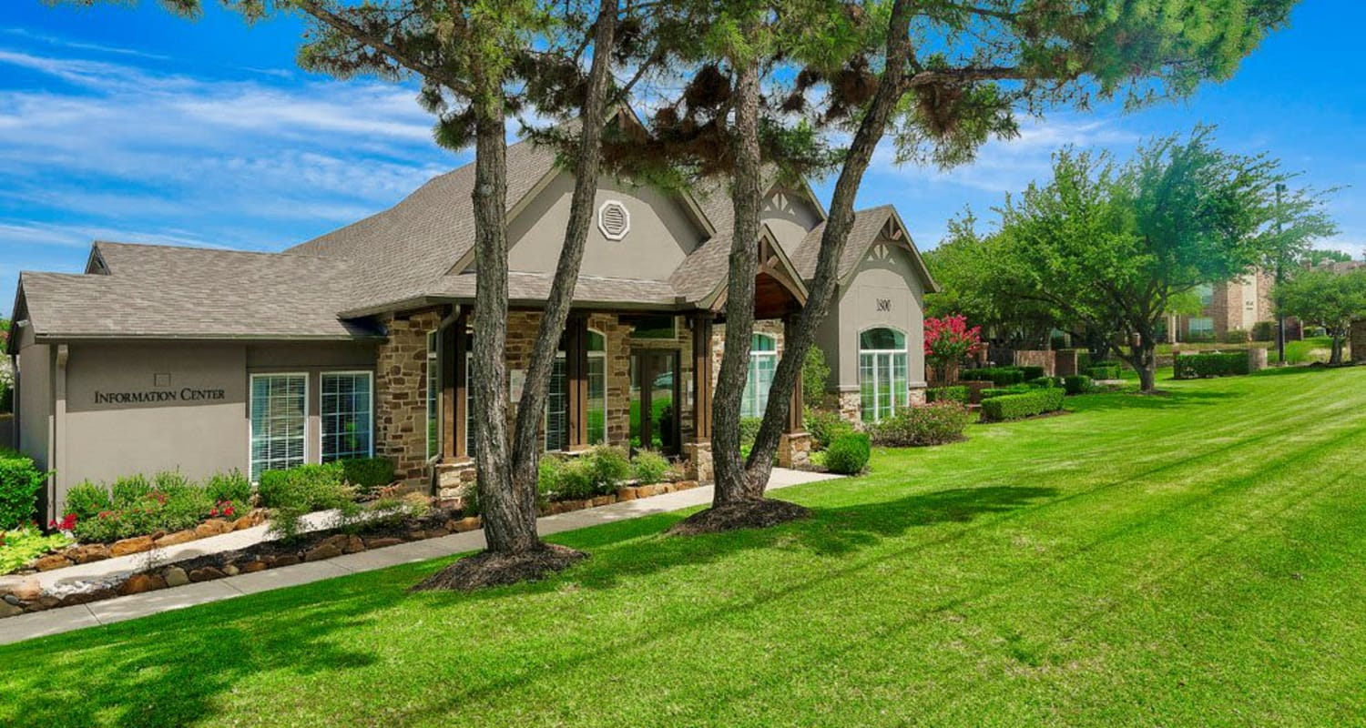 Well-maintained lawn and apartment home view at Village Green of Bear Creek in Euless, Texas