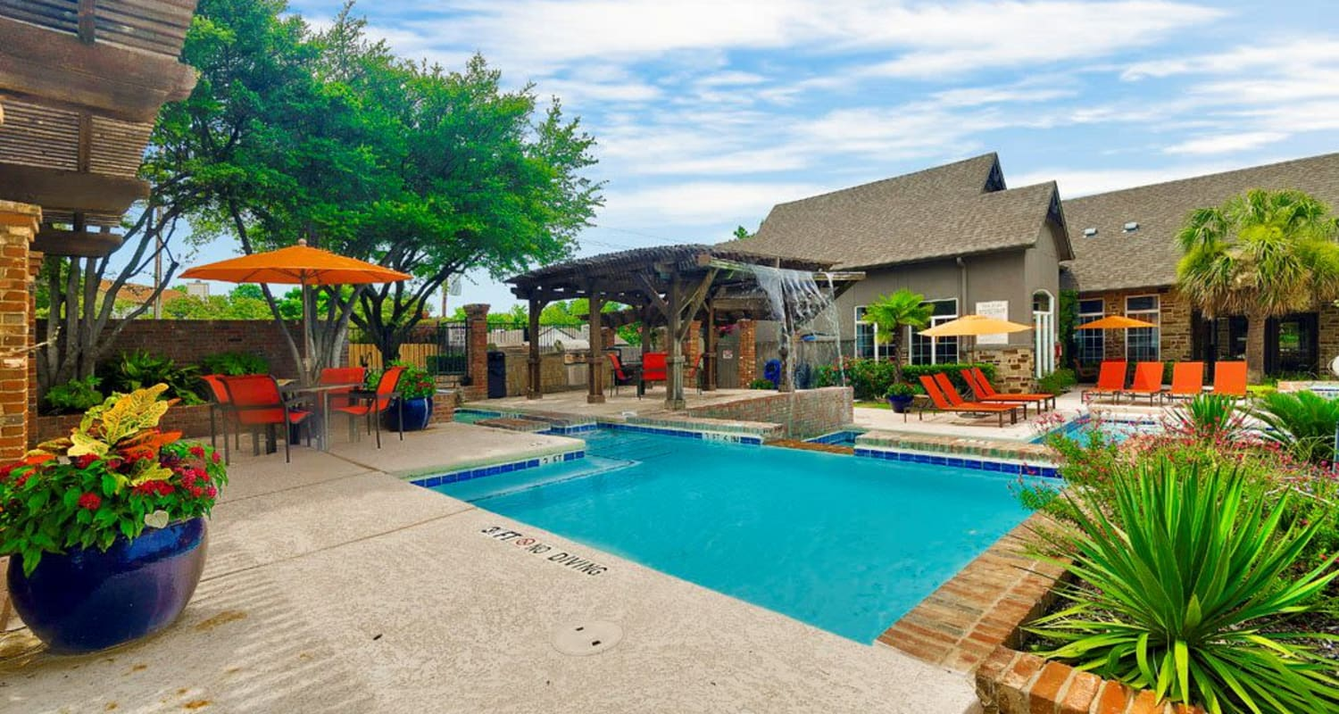 Enjoy a refreshing pool at Village Green of Bear Creek in Euless, Texas
