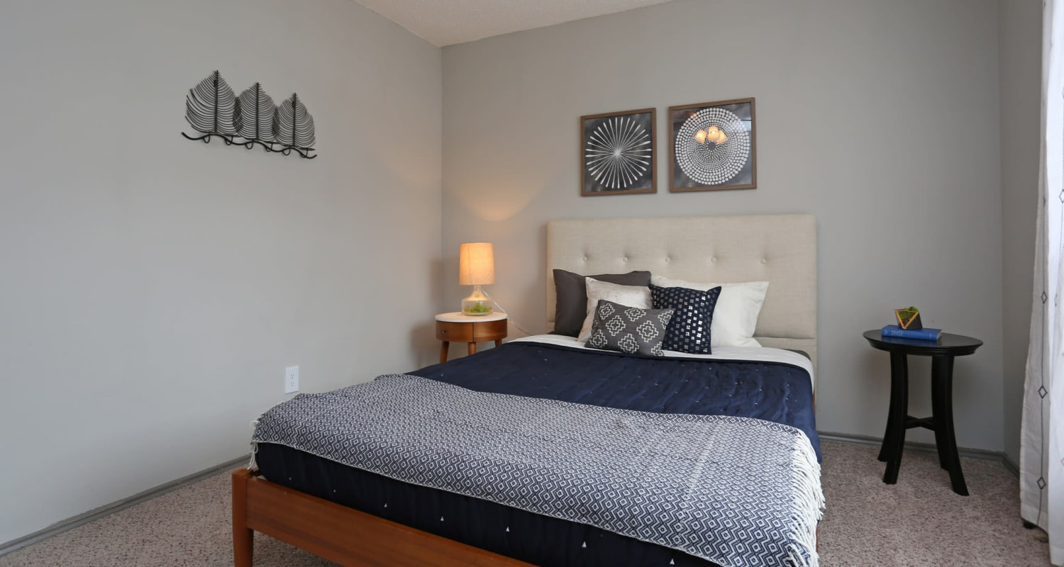 Comfy bed at Village Green of Bear Creek in Euless, Texas