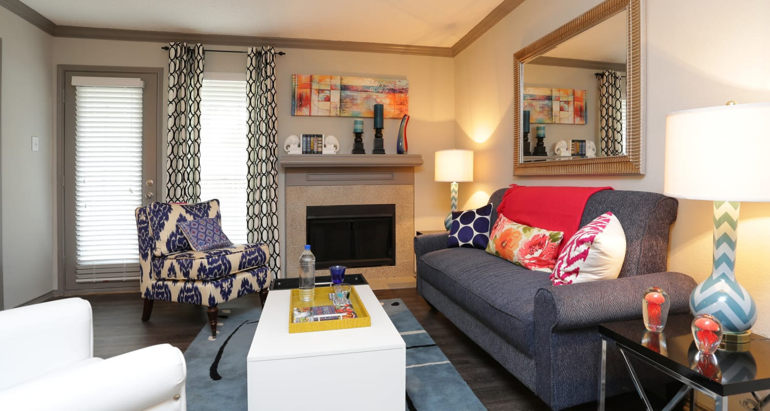 Cozy living room at Village Green of Bear Creek in Euless, Texas