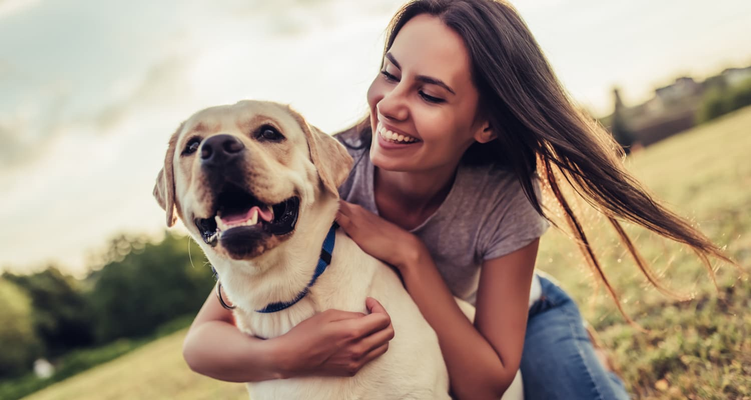 Resident and her dog loving their new neighborhood at Highlands at Alexander Pointe in Charlotte, North Carolina