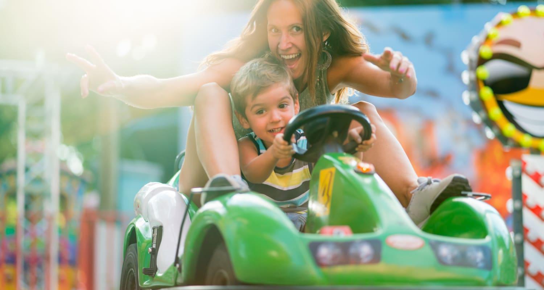 Mother and son enjoying the go-carts at Funtasticks Charlotte near Highlands at Alexander Pointe in North Carolina