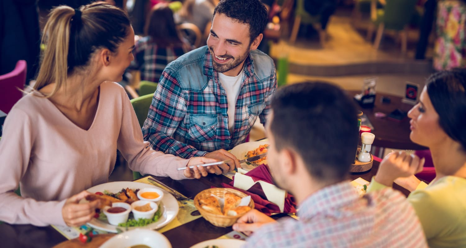 Residents enjoying a meal at one of the many restaurants near Highlands at Alexander Pointe in Charlotte, North Carolina