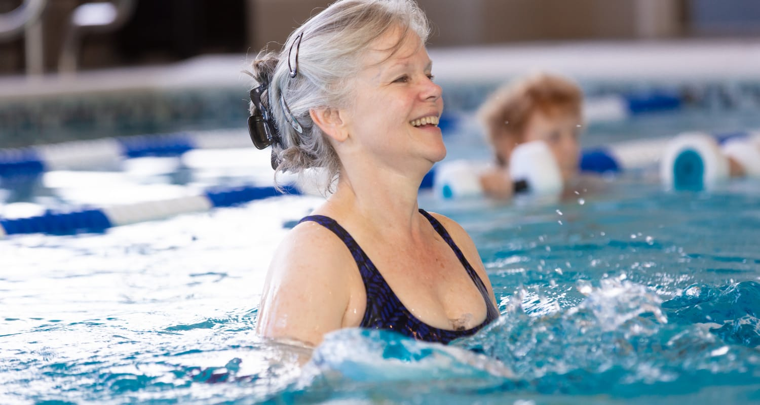 A resident in the community pool at Touchmark at Fairway Village Health & Fitness Club in Vancouver, Washington