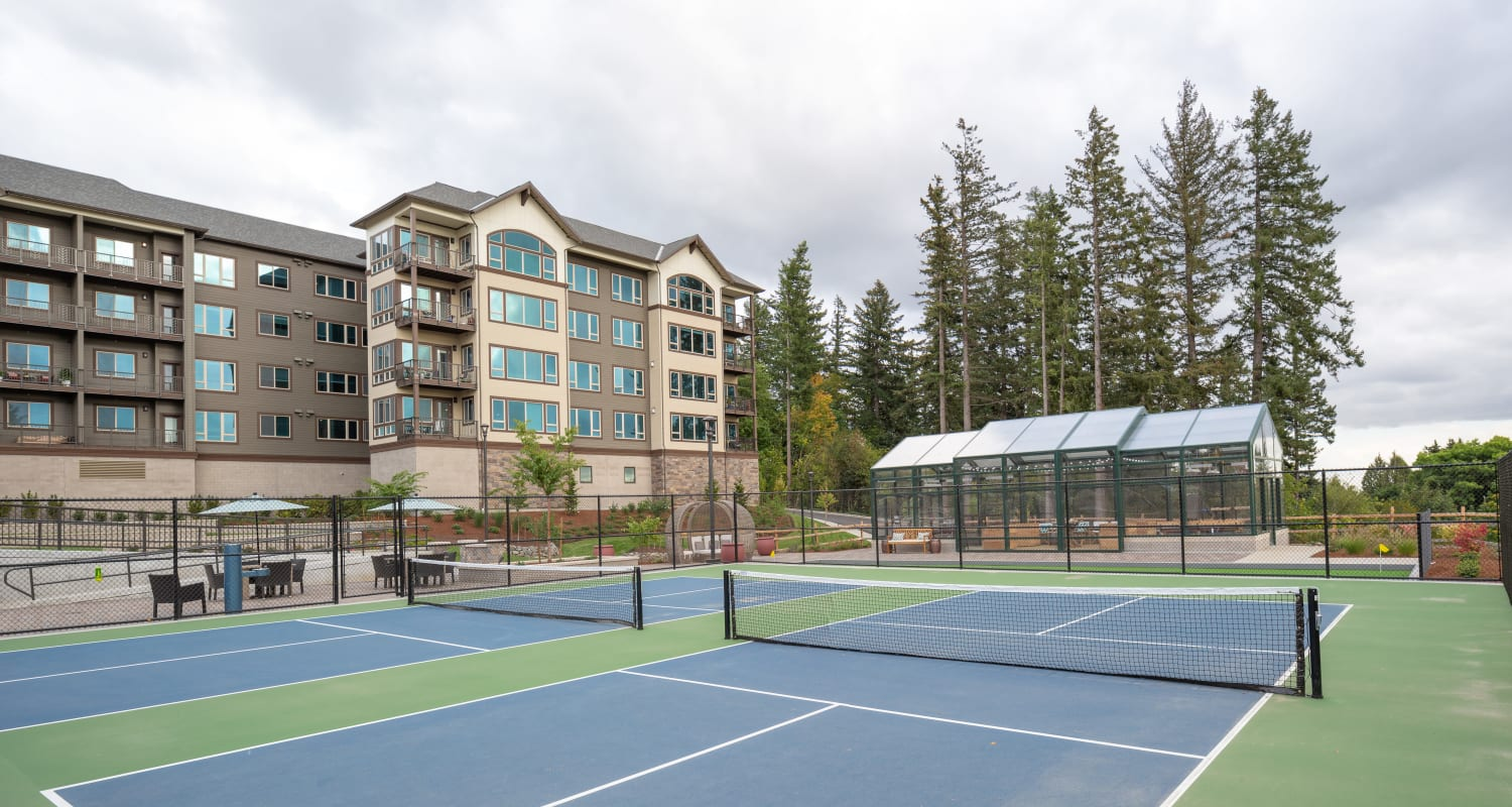 Outdoor tennis courts at Touchmark in the West Hills Health & Fitness Club in Portland, Oregon