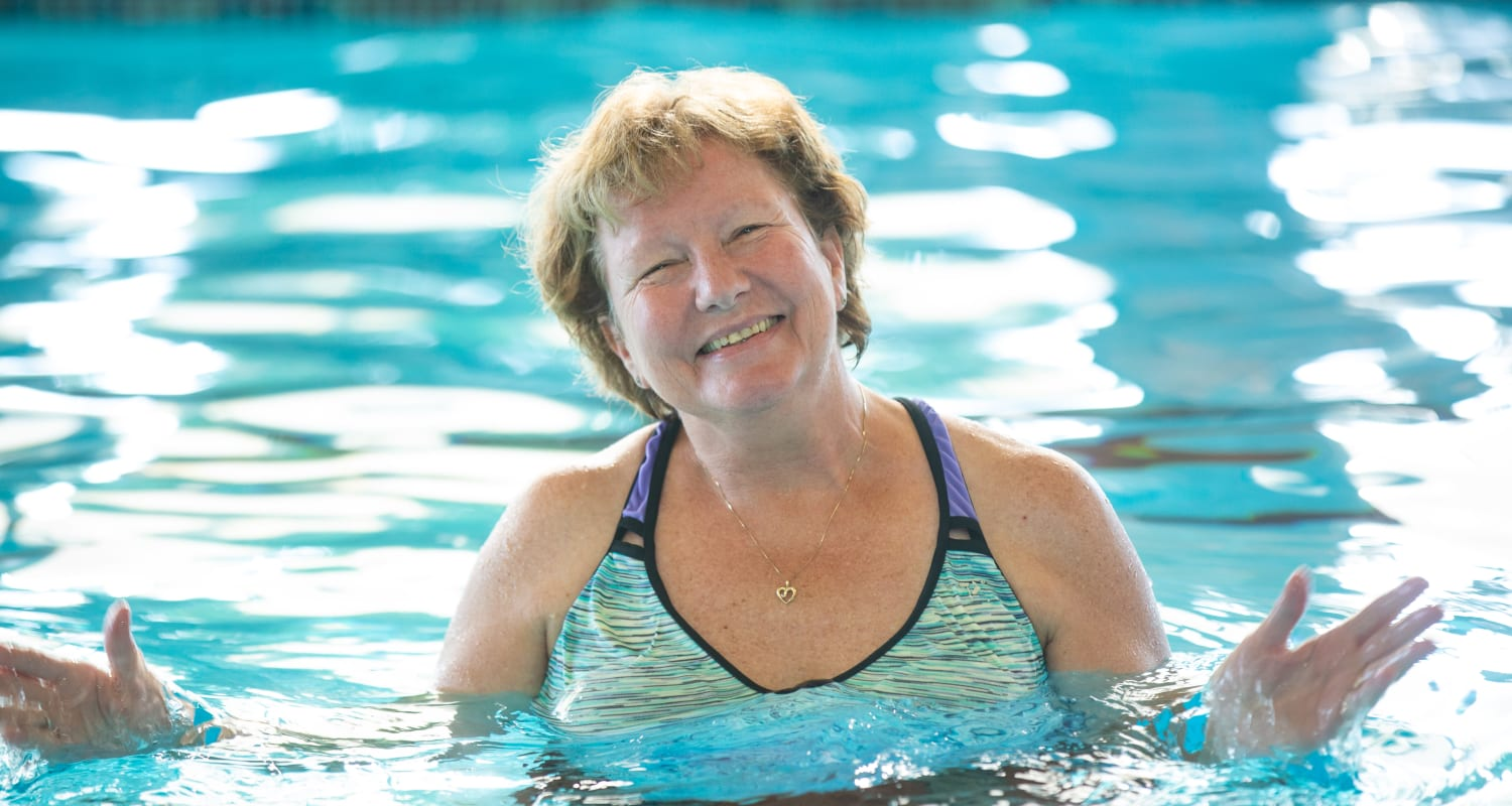 A happy resident in the pool at Touchmark on West Century Health & Fitness Club in Bismarck, North Dakota