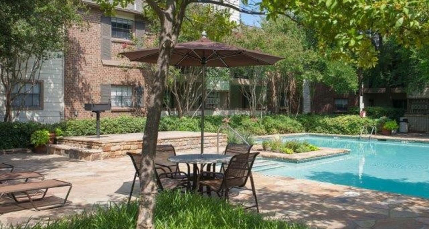 Resort-style poolside seating at The Regent in Dallas, Texas