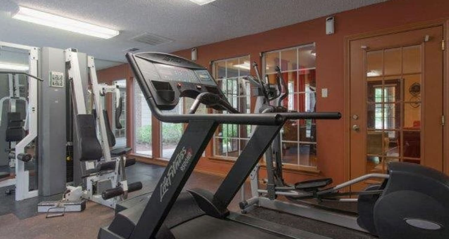 Resident gym with individual workout stations at The Regent in Dallas, Texas