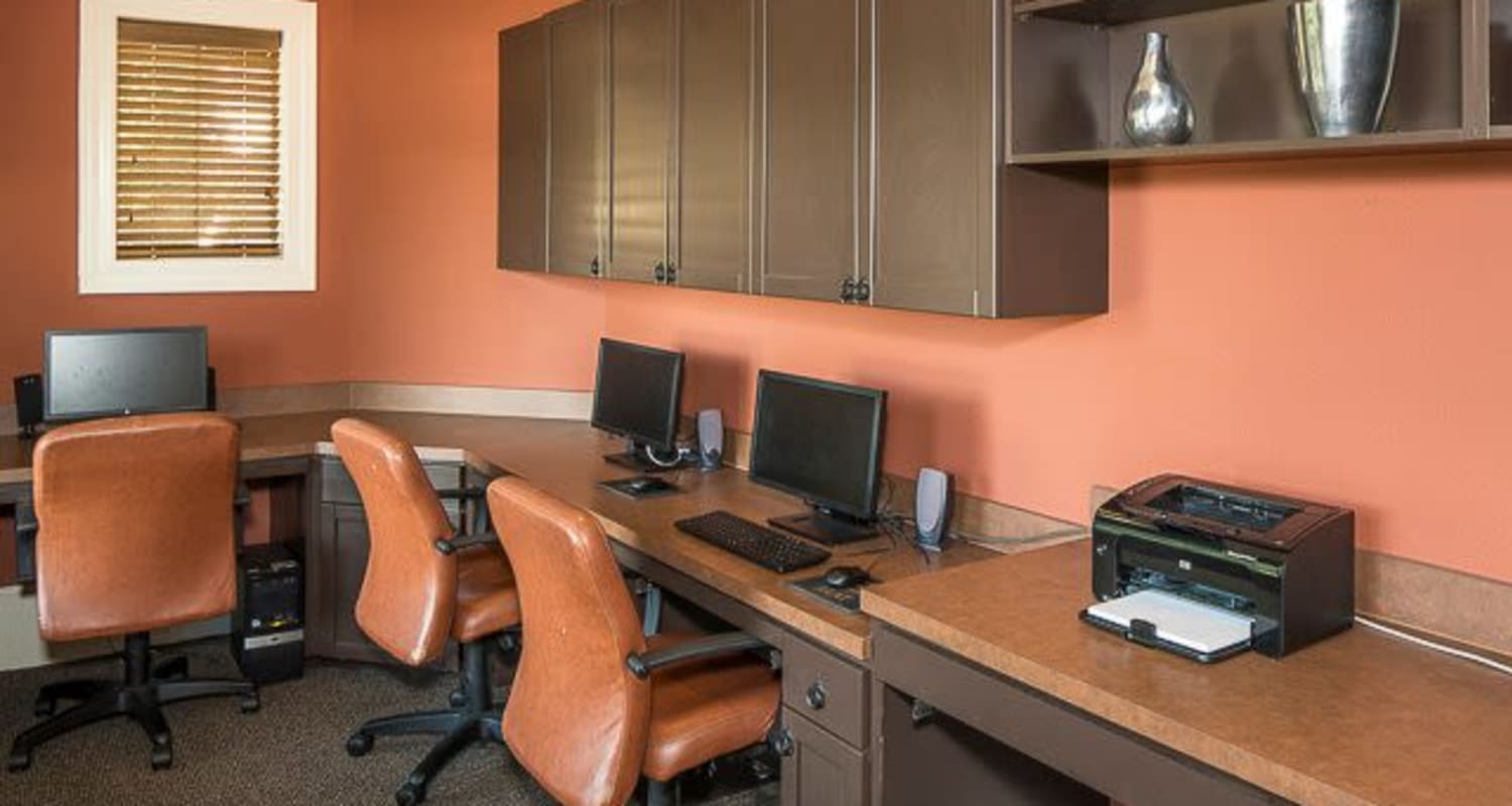 Secluded business center with complimentary desktop computers for resident use at Ranch ThreeOFive in Arlington, Texas