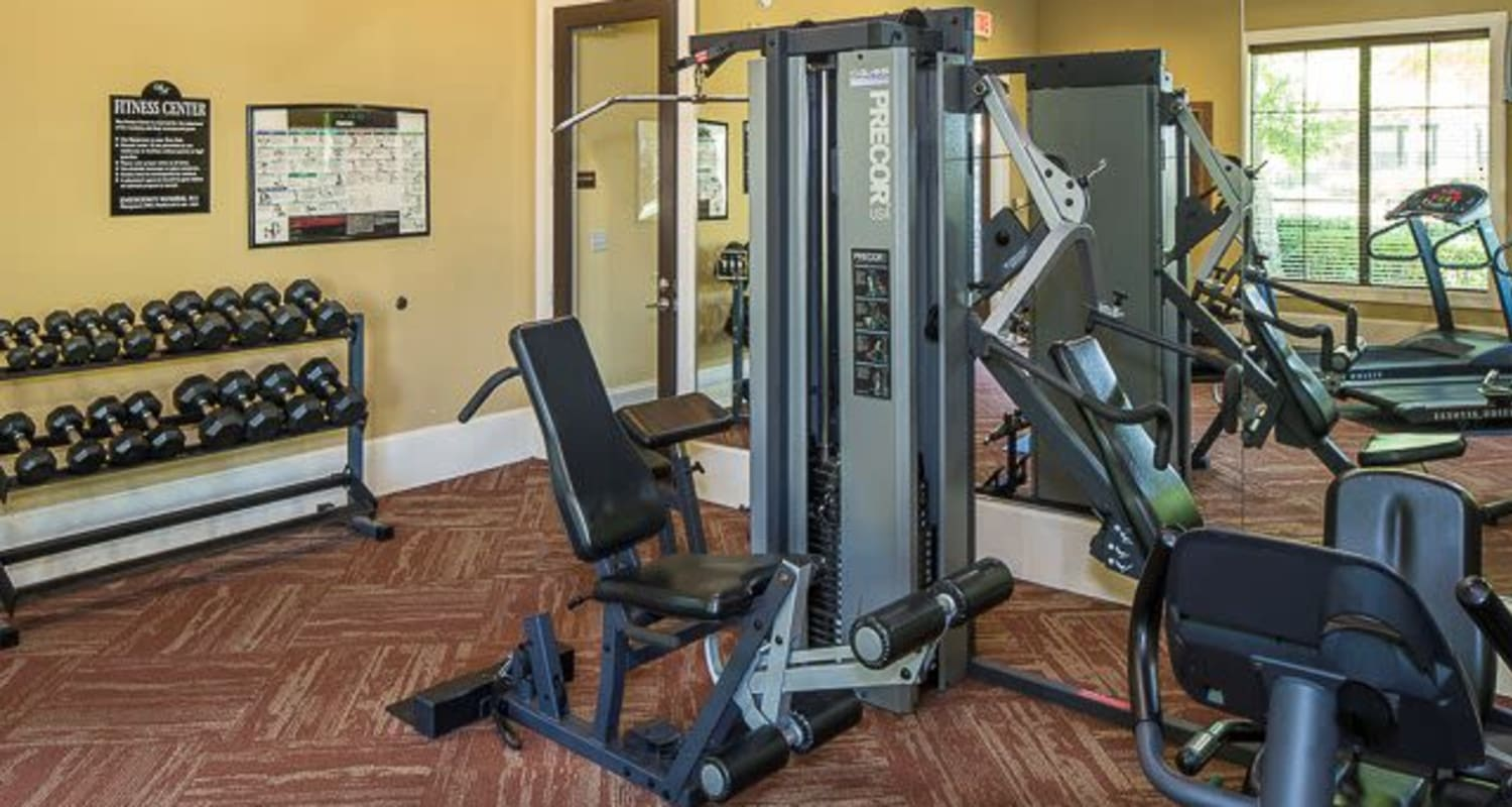 Fitness center with individual workout stations at Ranch ThreeOFive in Arlington, Texas