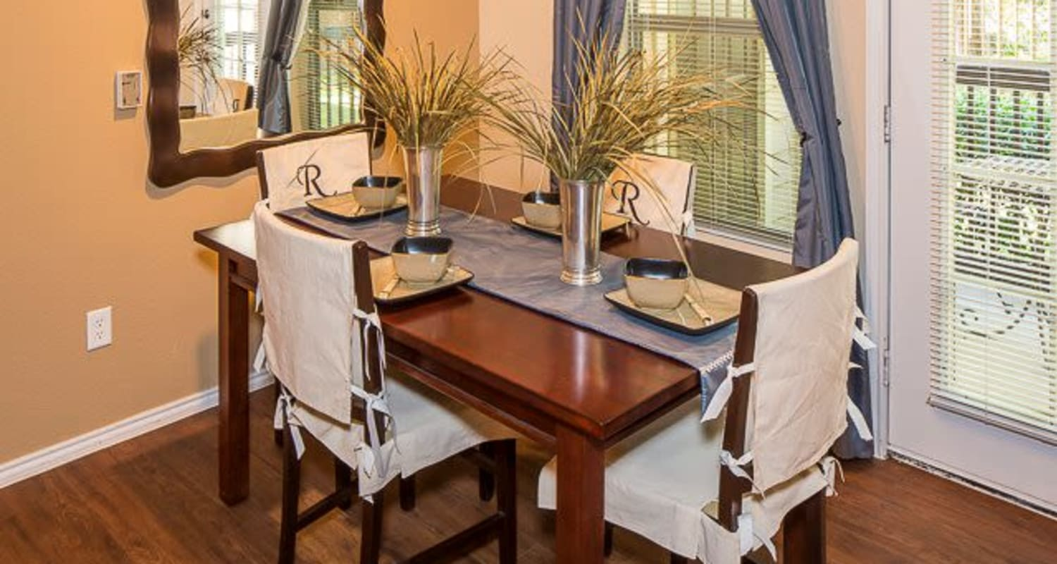 Spacious dining room with wooden floors at Ranch ThreeOFive in Arlington, Texas