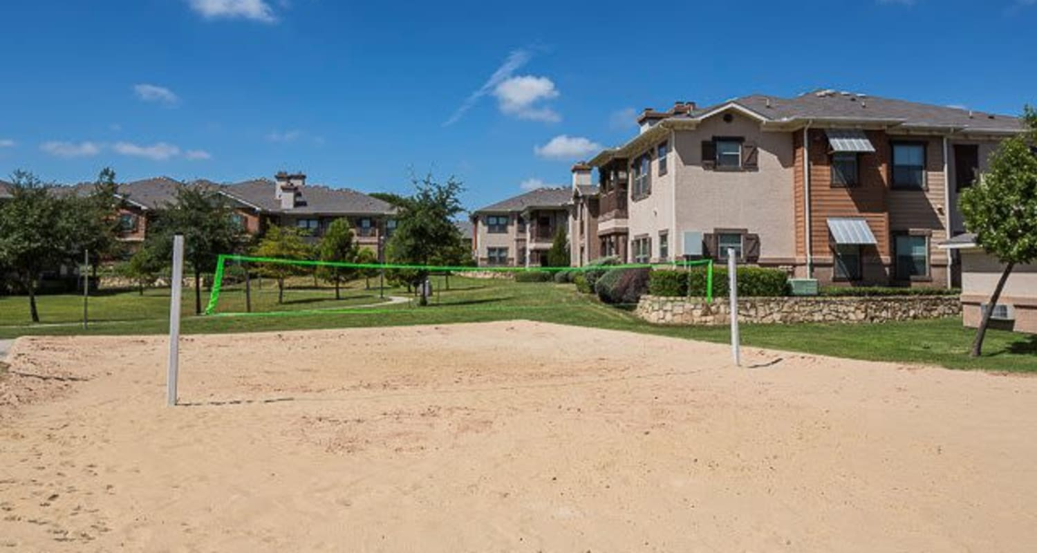 Outdoor volley ball court with sand at Ranch ThreeOFive in Arlington, Texas