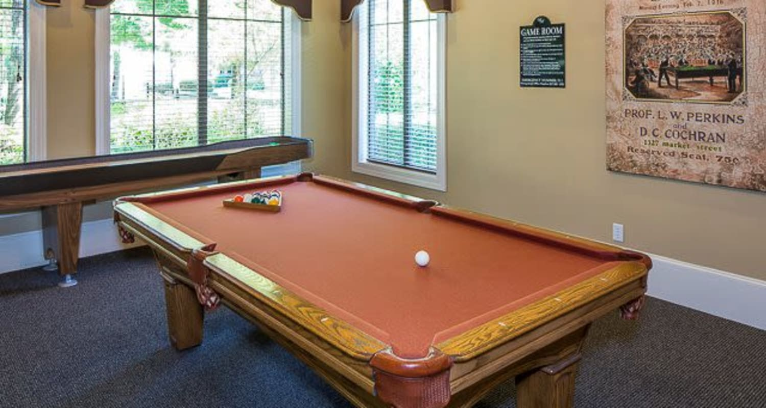 Rustic game room with a billiards table and a shuffle board at Ranch ThreeOFive in Arlington, Texas