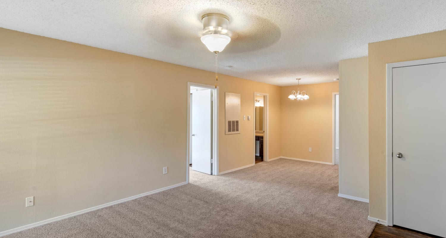 Open-concept floor plan with plush carpeting at The Logan in Bedford, Texas