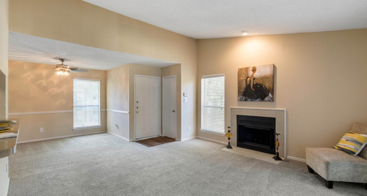 Large living room with plush carpeting at The Logan in Bedford, Texas