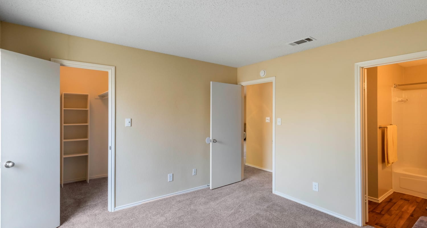 Large master bedroom with a walk-in closet at The Logan in Bedford, Texas