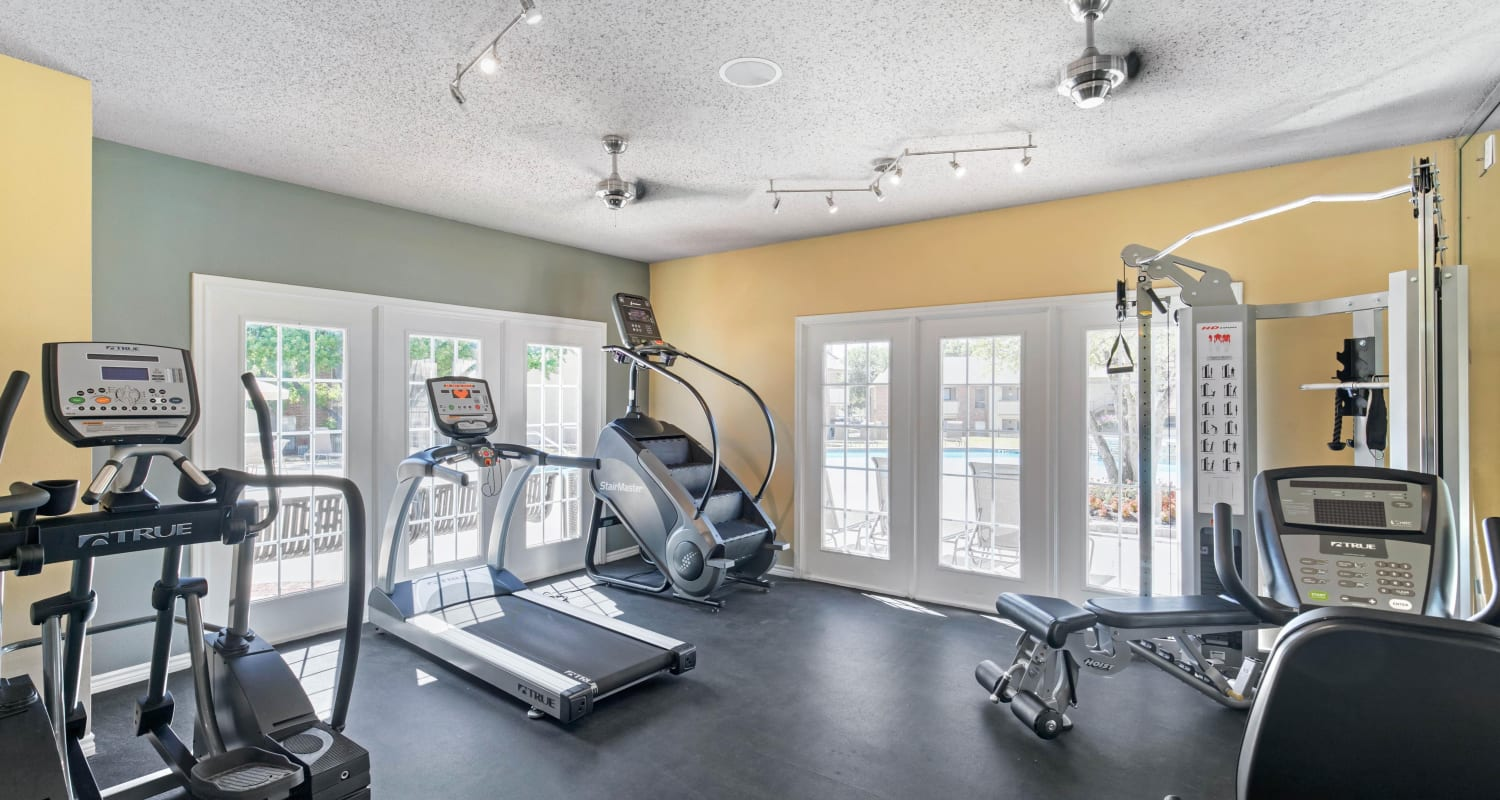 Resident fitness gym with individual workout stations at The Logan in Bedford, Texas