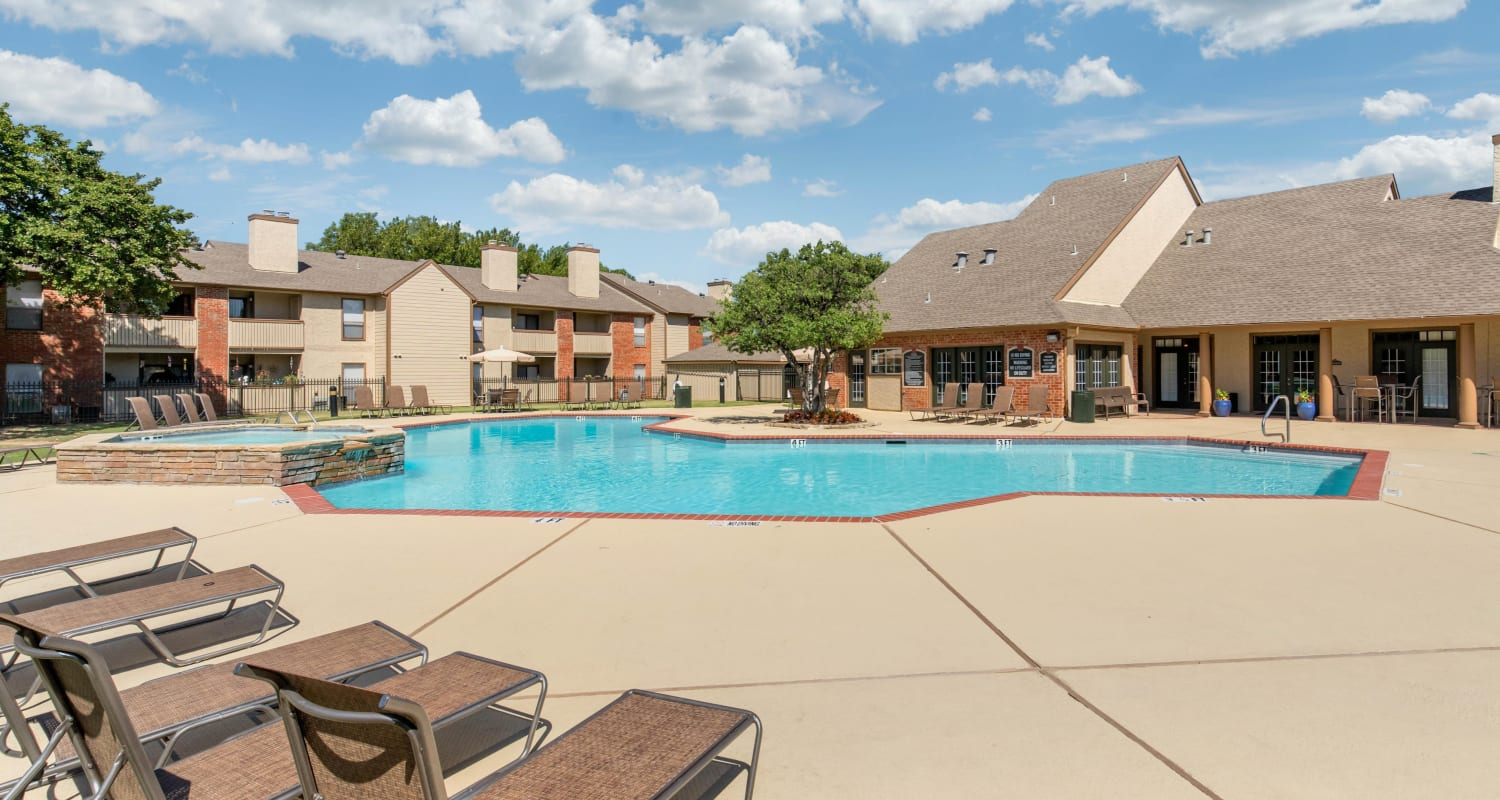 Pool with sundeck and lounge chairs at The Logan in Bedford, Texas