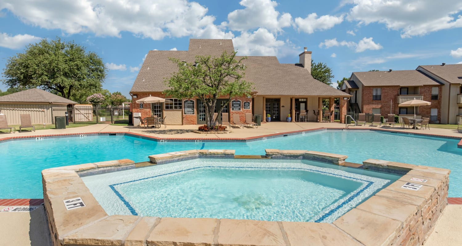Swimming pool with a raised hot tub at The Logan in Bedford, Texas