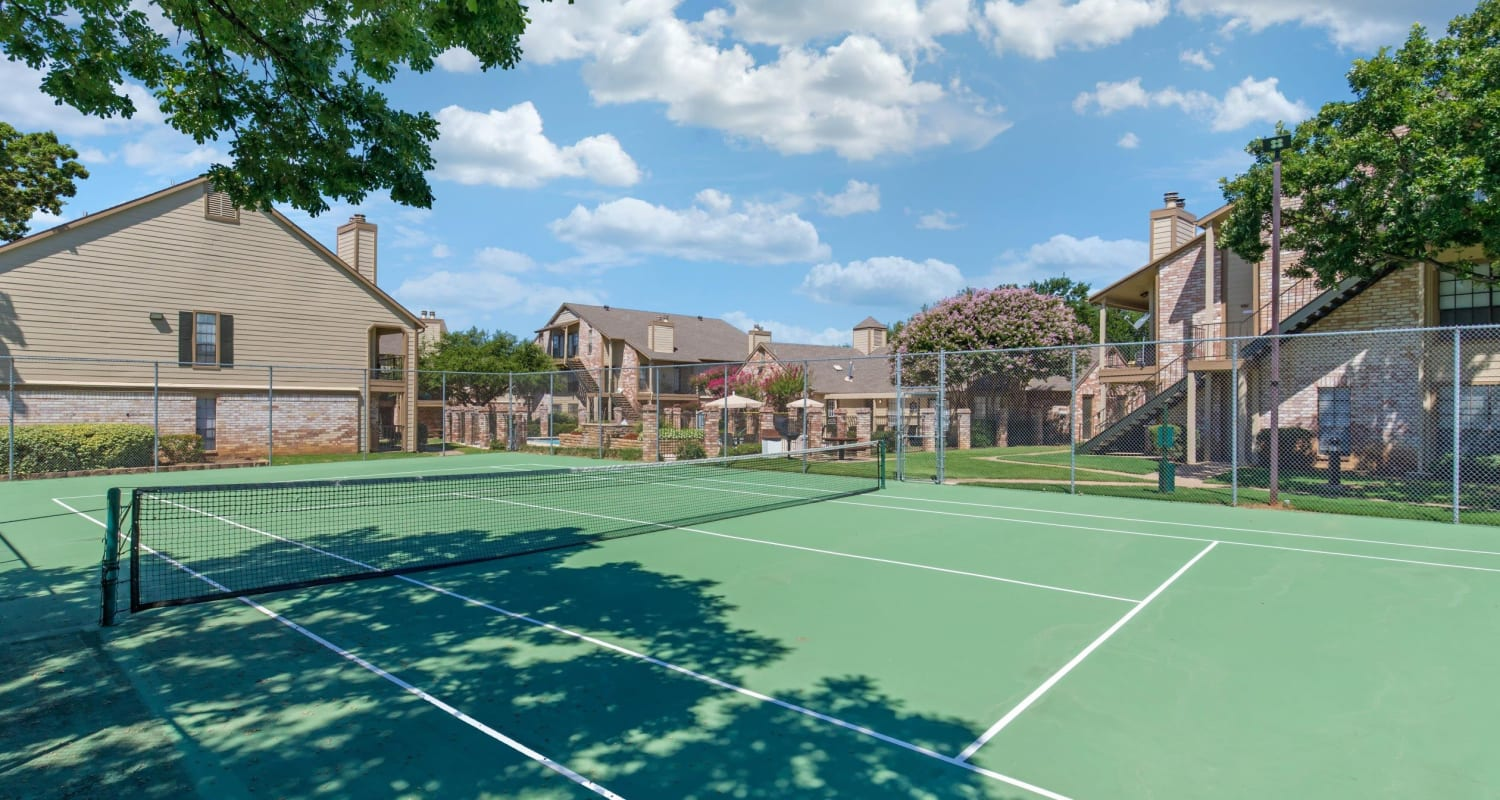 Full-size tennis court at The Logan in Bedford, Texas
