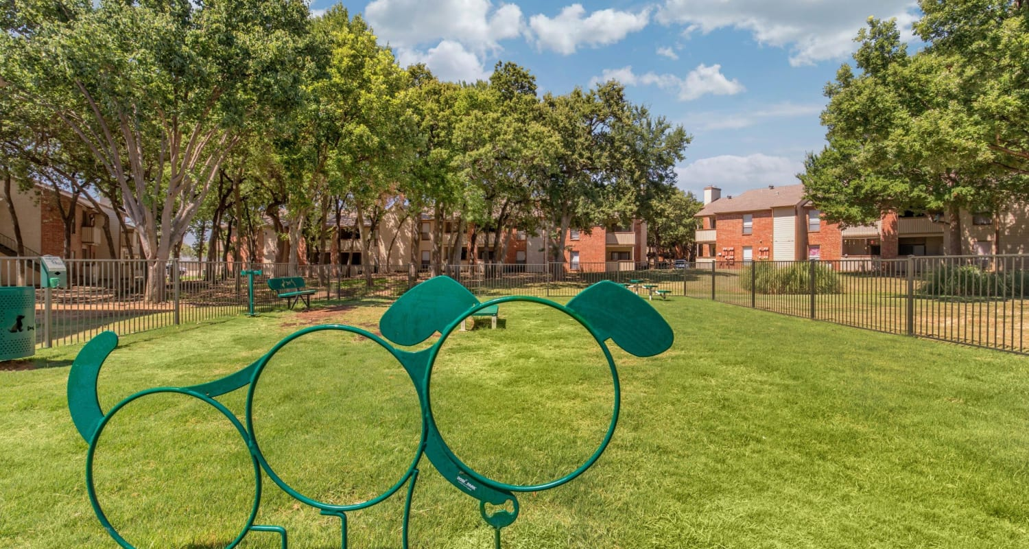 Dog park with a nicely  manicured lawn at The Logan in Bedford, Texas