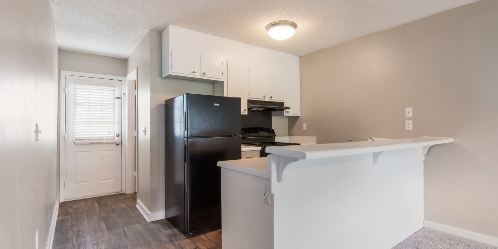 Kitchen with black appliances at 1022 West Apartment Homes in Gaffney, South Carolina