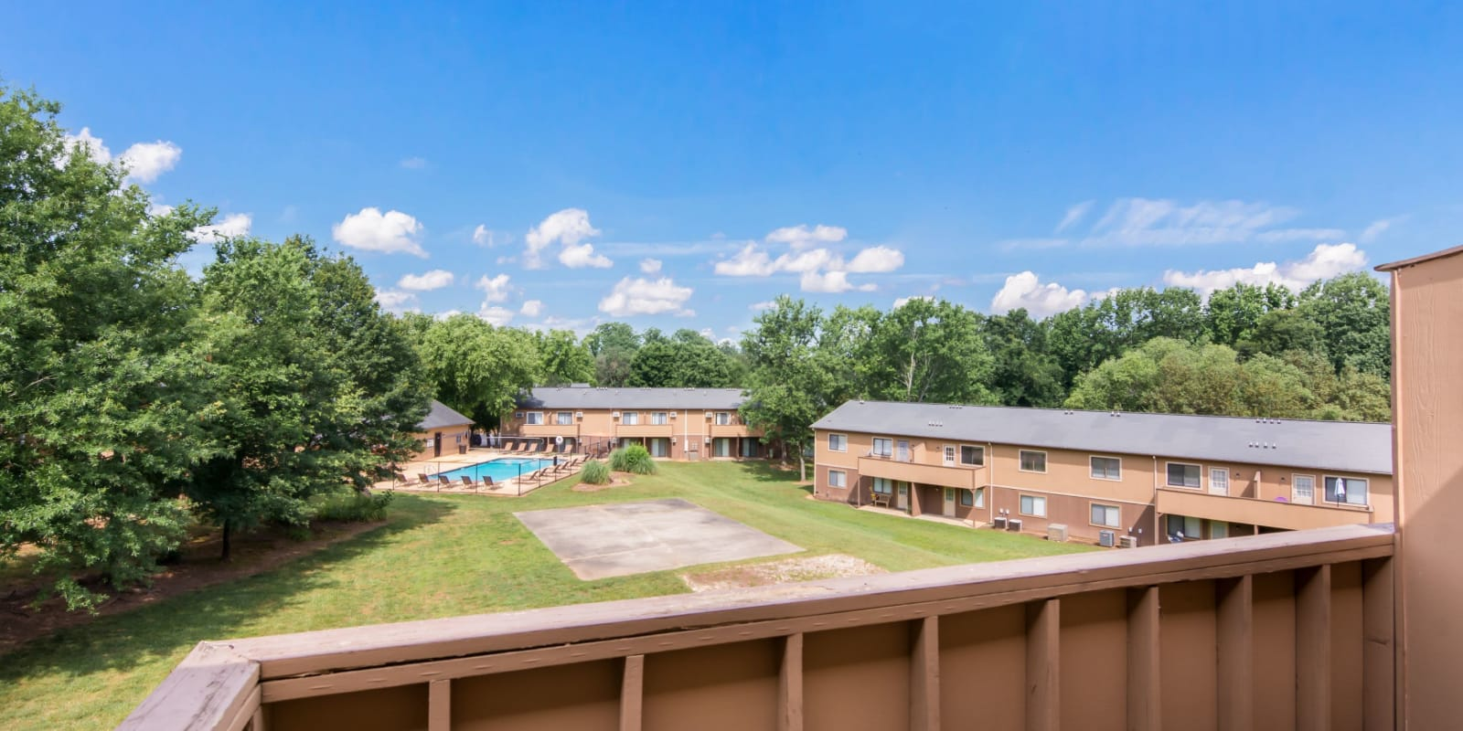 Private balcony overlooking the well-manicured landscape at 1022 West Apartment Homes in Gaffney, South Carolina