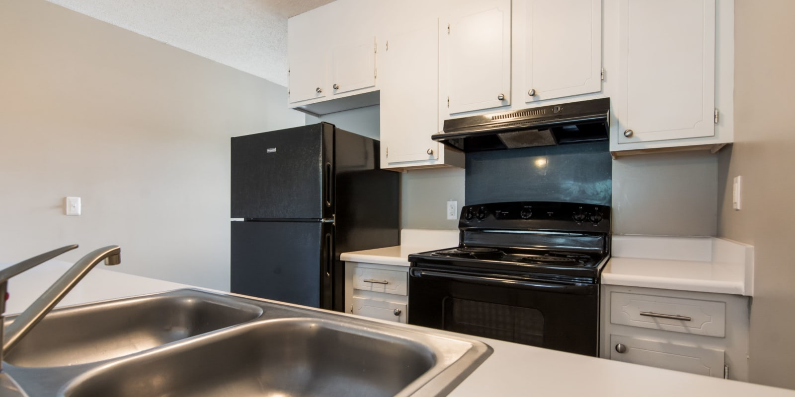 Kitchen with a stainless-steel sink at 1022 West Apartment Homes in Gaffney, South Carolina