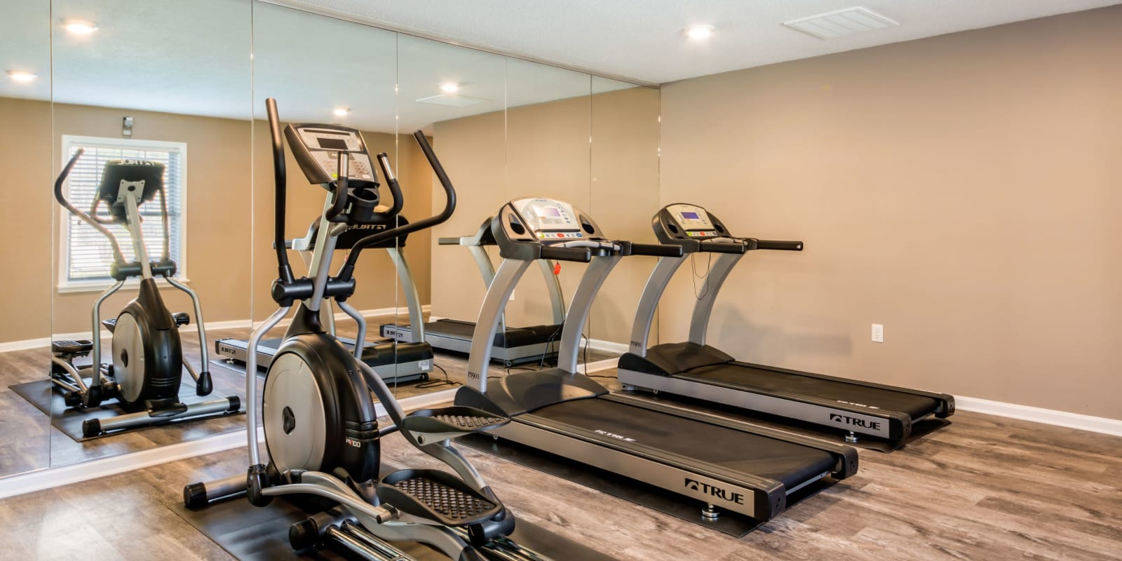 Fitness center with treadmills at Alexander Station Apartment Homes in Salisbury, North Carolina