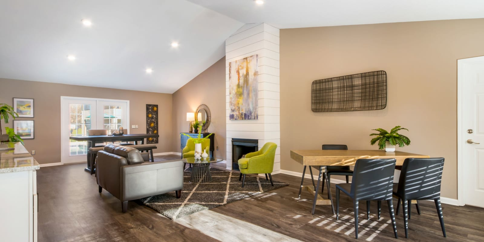 A club house with plenty of comfortable seating at Alexander Station Apartment Homes in Salisbury, North Carolina